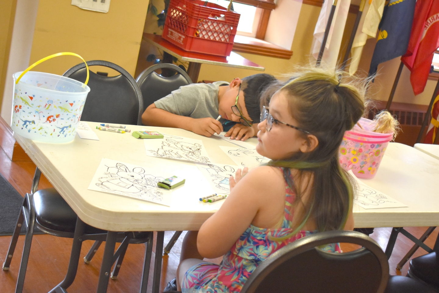 Children enjoy coloring pages on April 13, 2019 at the Post's annual easter egg hunt.